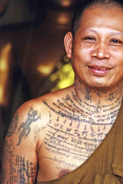 tatooed thai monk-AsiaPhotoStock