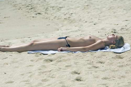 topless sunbather-AsiaPhotoStock