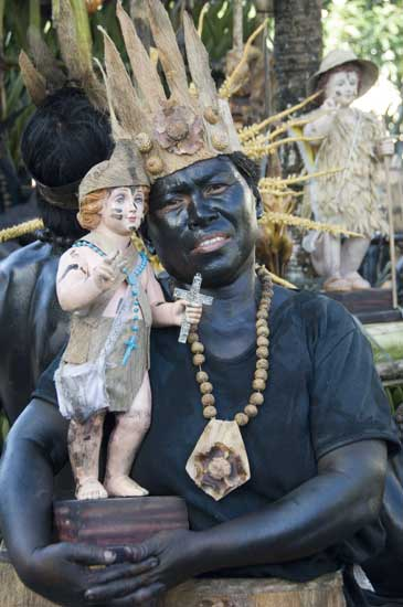 tribesman and santo nino-AsiaPhotoStock