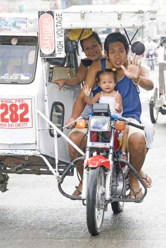 family in tricycle-AsiaPhotoStock