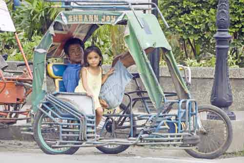 girl in tricycle-AsiaPhotoStock