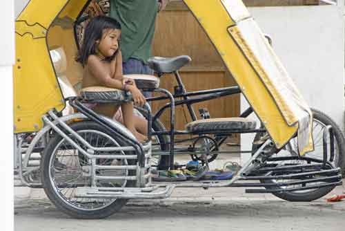 girl on a tricycle-AsiaPhotoStock
