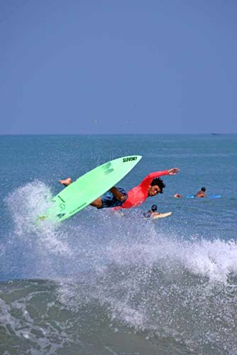 tumble in surf bali-AsiaPhotoStock