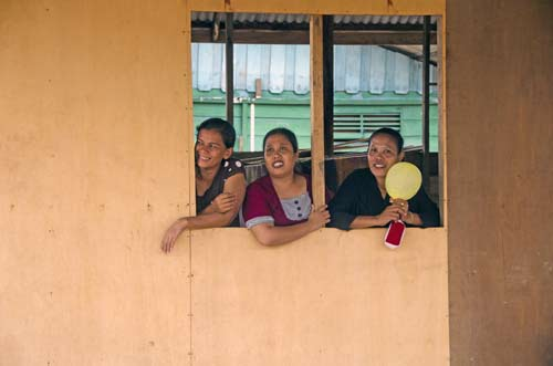 women at window-AsiaPhotoStock
