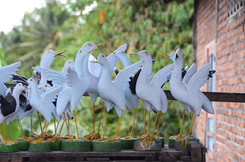 wooden birds carvings-AsiaPhotoStock