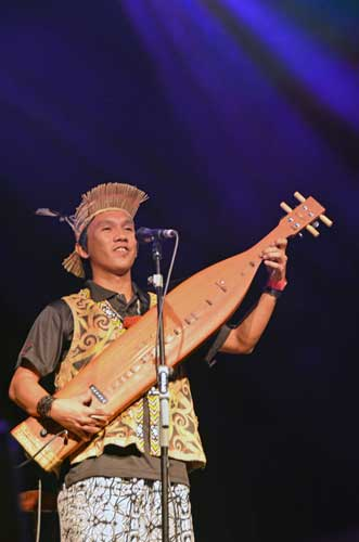 young sape player-AsiaPhotoStock